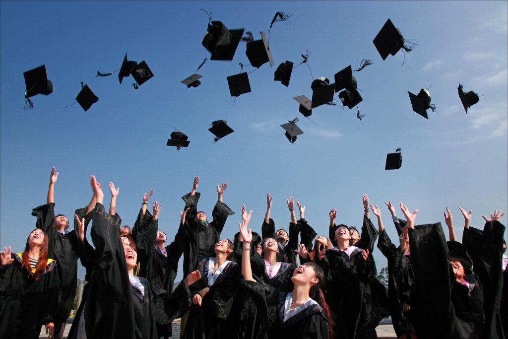 A group of students throwing their graduation caps in the air