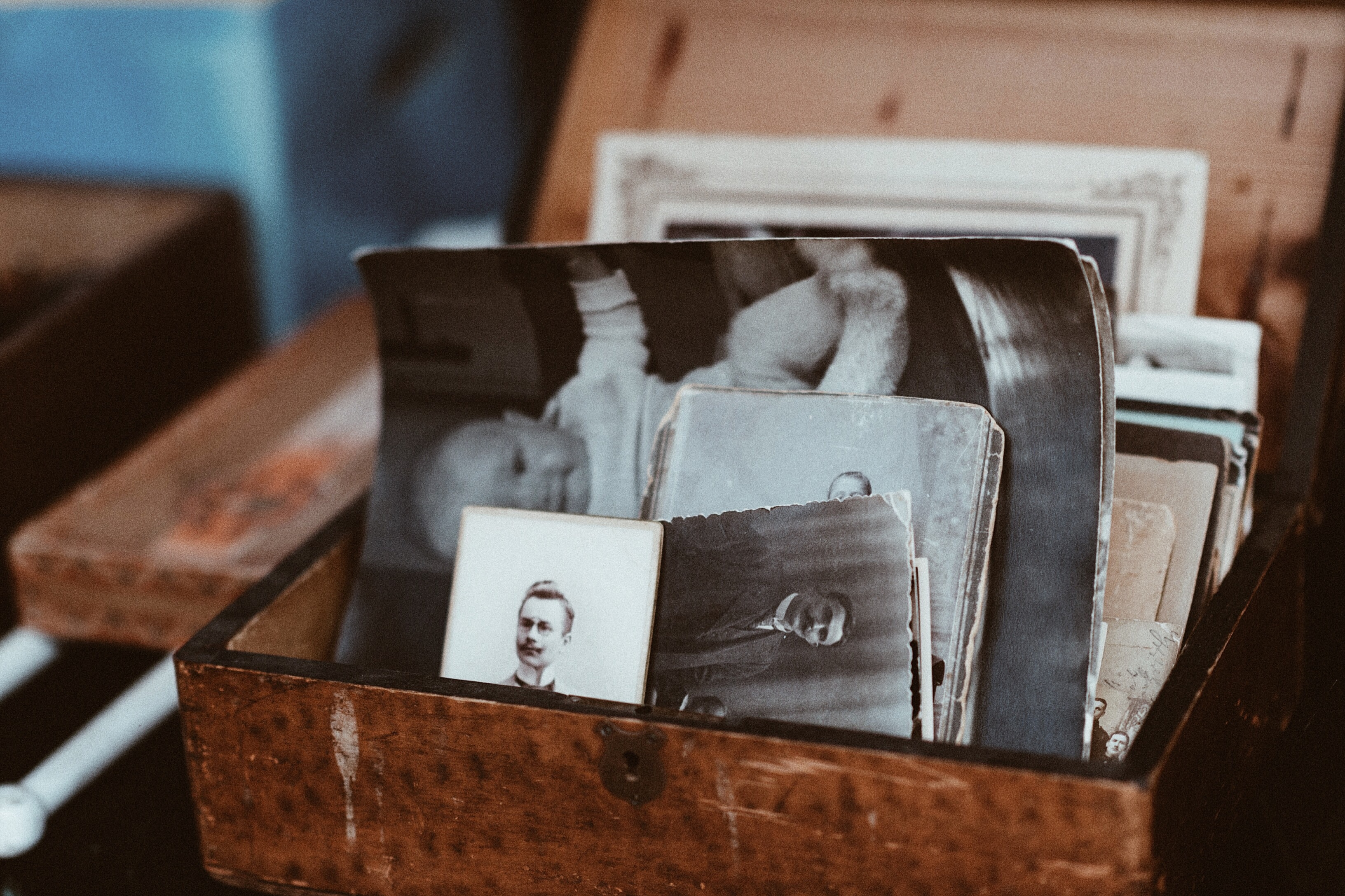 An old wooden box containing old black-and-white photos