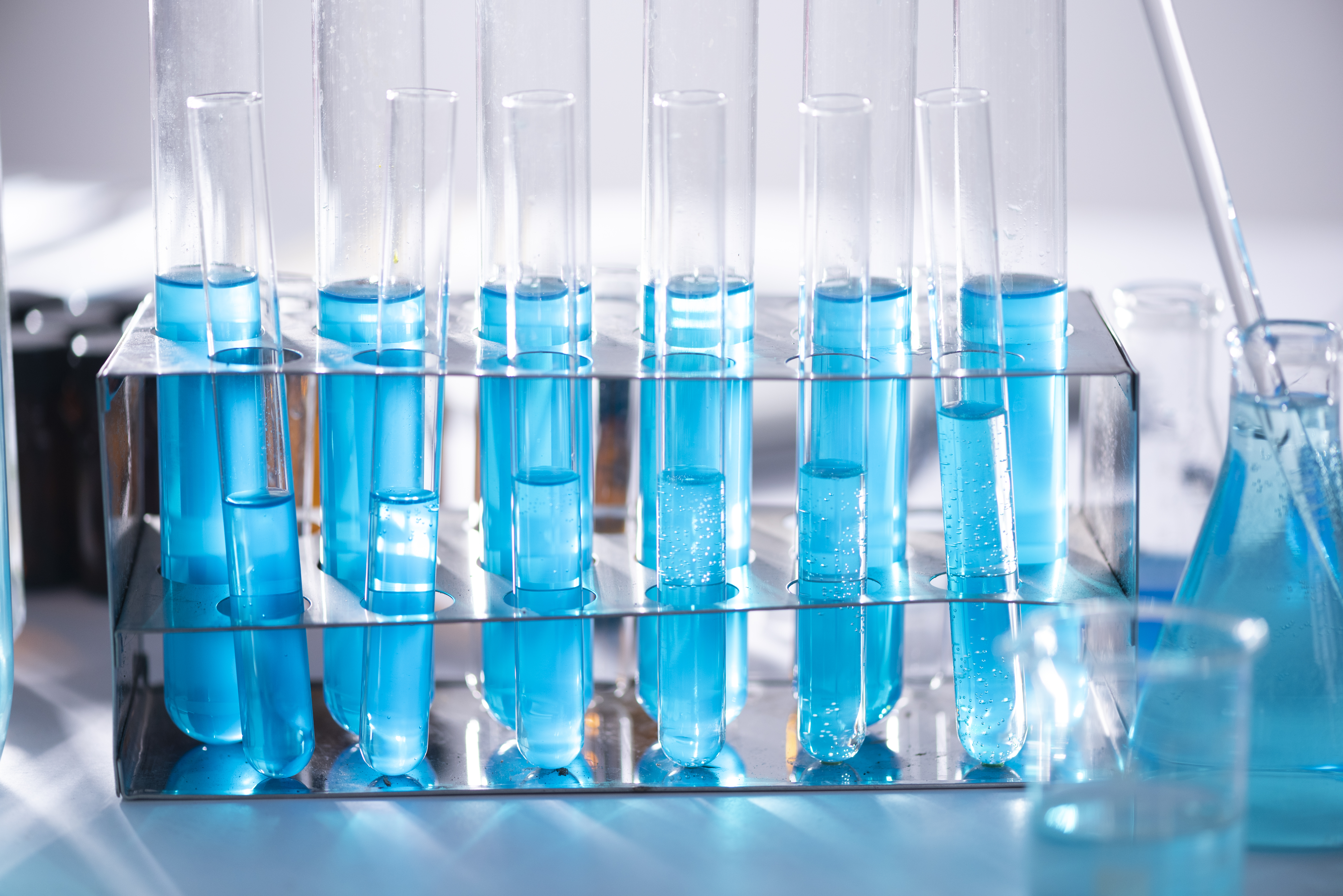 A set of vials containing a blue chemical