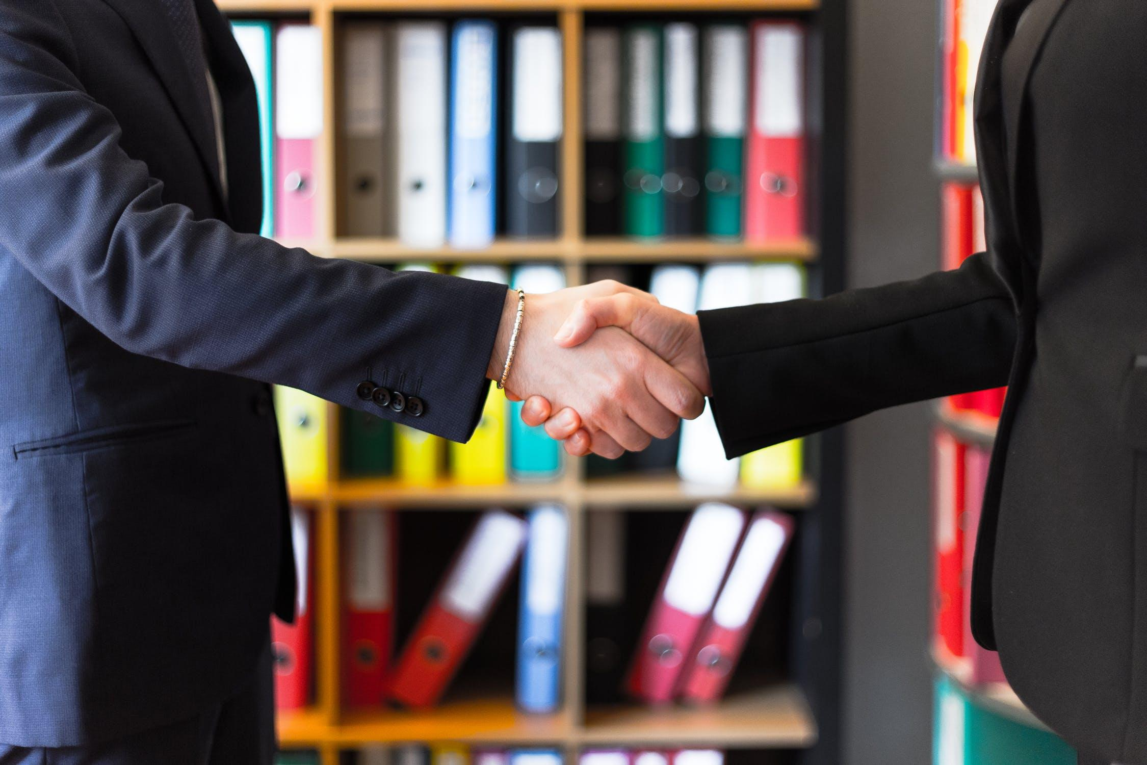 This is an image of two people shaking hands, just like they would at a college career fair.
